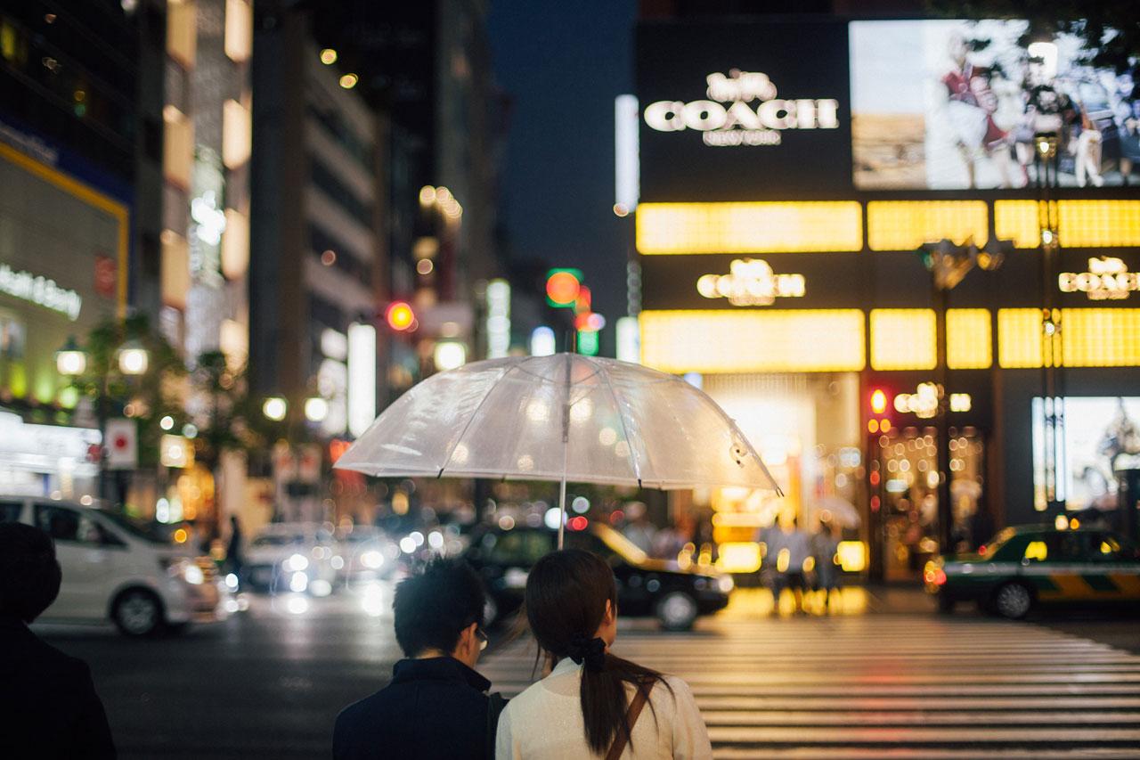 Evening in Tokyo, Ginza, couple under umbrella