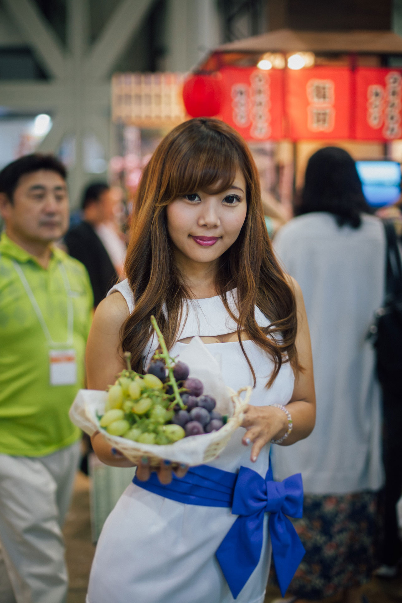 Girl from Japan holding grapes