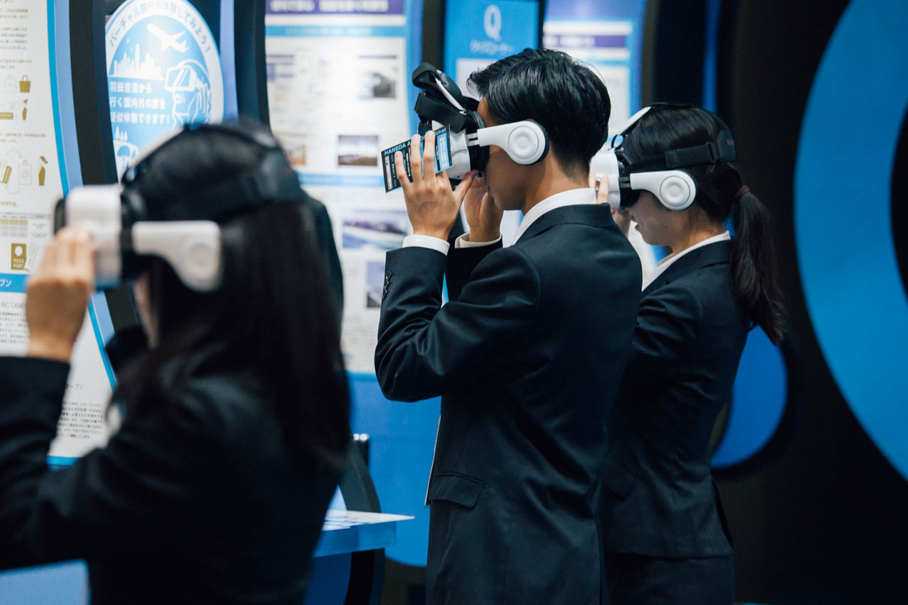 man and woman wearing VR headset